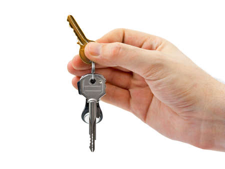key to freedom: Hand and keys isolated on white background