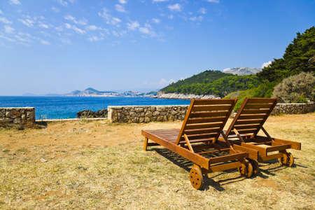 croatia dubrovnik: Chairs on beach at Dubrovnik, Croatia - vacations background Stock Photo