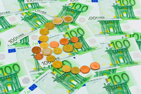 Euro coins and banknotes - abstract business background photo