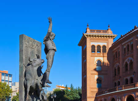 Toreador statue and bullfighting arena in Ventas Plaza - Madrid Spain photo