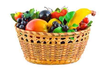 Basket with fruits  artificial  isolated on white background photo