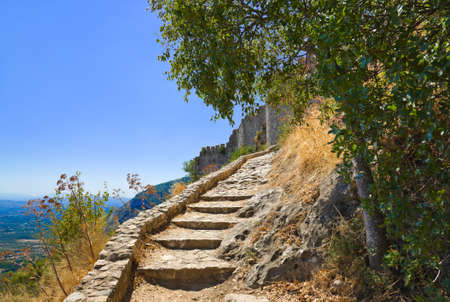 peloponnese: Stairs to old fort in Mystras, Greece - archaeology background
