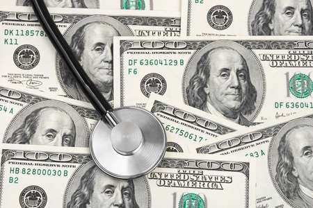 Stethoscope on money background - medical concept photo