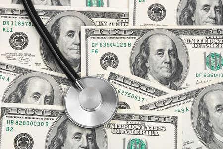 Stethoscope on money background - medical concept photo