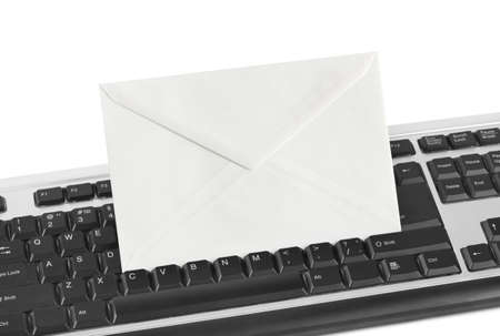 Computer keyboard and letter isolated on white background photo