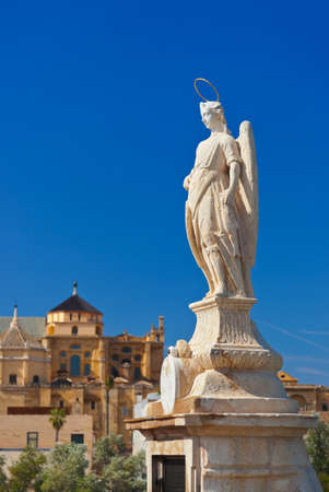 Archangel Raphael statue on bridge at Cordoba Spain - nature and architecture background photo