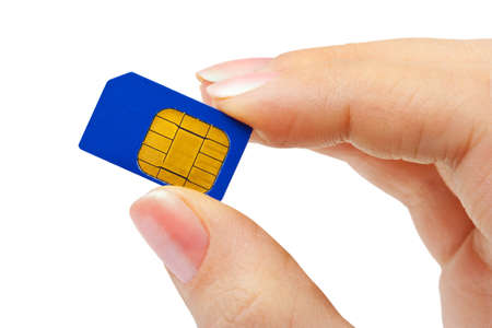 Hand and phone sim card isolated on white background photo
