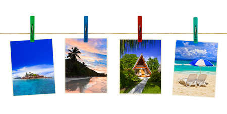 Vacation beach photography on clothespins isolated on white background photo