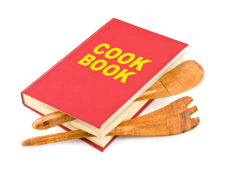 Cookbook and kitchenware isolated on white background photo
