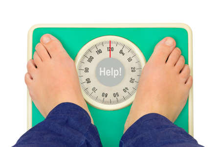 Woman feet and weight scale Help  isolated on white background photo