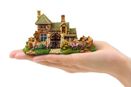 hands holding house: Hand and house isolated on white background