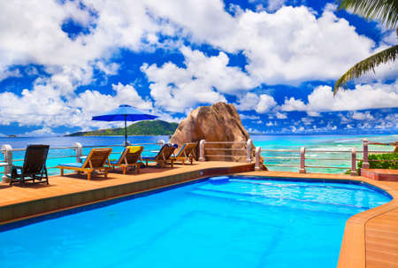 Pool at tropical beach - vacation background Stock Photo - 13670014