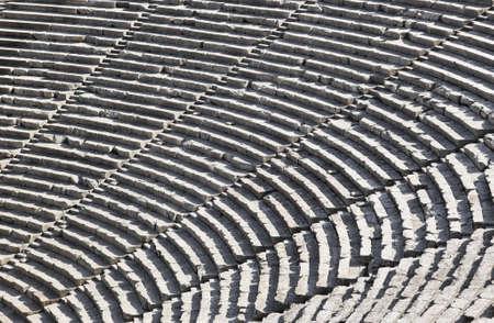 ancient greece: Ruins of Epidaurus amphitheater, Greece - archaeology background Stock Photo