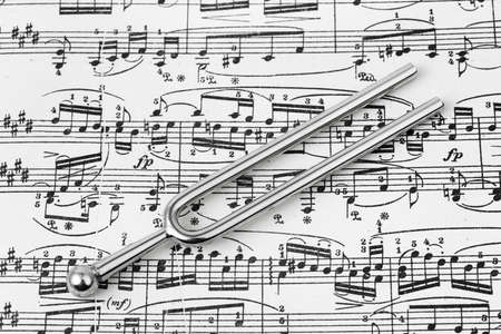 Pitchfork on sheet music - abstract art background photo