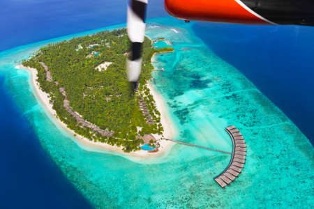 Tropical island at Maldives - aerial view photo