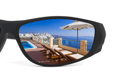 Resort reflection in sunglasses isolated on white background photo