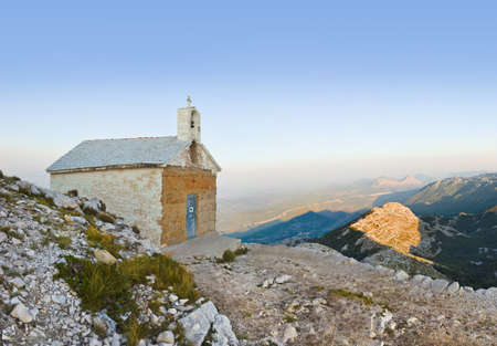 Old church in mountains at Biokovo, Croatia - religion background photo