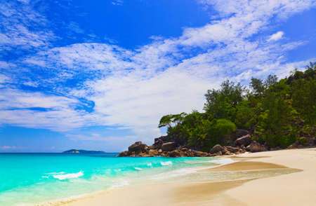 Tropical beach at island Praslin, Seychelles - vacation background photo