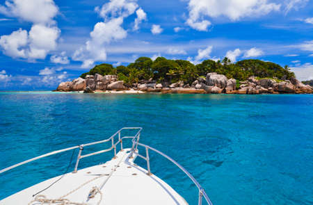 Tropical island and boat - vacation background photo