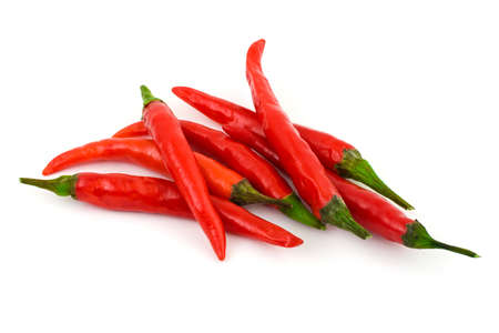 Heap of red hot chili pepper isolated on white background photo