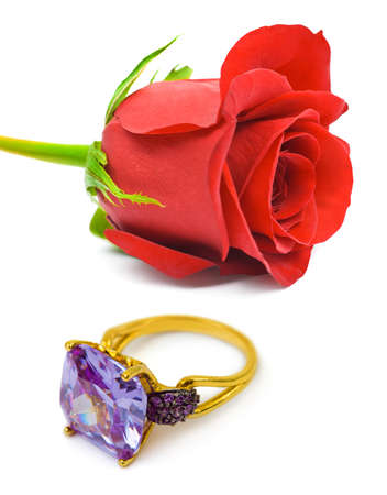 Rose and golden ring isolated on white background photo