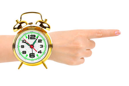 Pointing hand and alarm clock like a watch isolated on white background photo