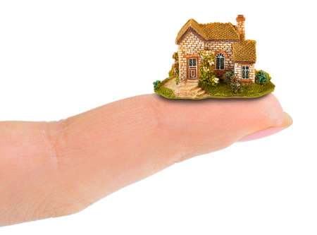 Finger and house isolated on white background Stock Photo - 15348217