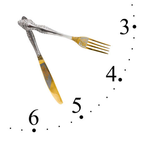 Clock made of fork and knife isolated on white background photo