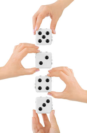 Hands and dices isolated on white background photo