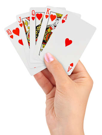 flush: Playing cards in hand isolated on white background Editorial