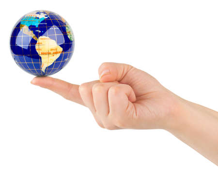 Hand and globe isolated on white background photo