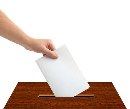 election vote: Hand with ballot and box isolated on white background Stock Photo