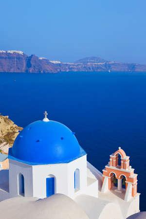 santorini caldera: Santorini church  Oia , Greece - vacation background