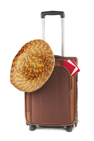 Travel case, hat and ticket isolated on white background photo