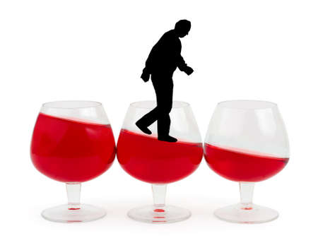 Wine glasses and alcoholic man isolated on white background photo