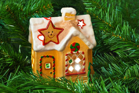 gingerbread house: Lighting house and christmas tree - abstract holiday background