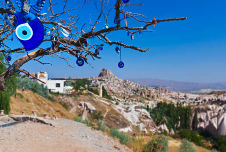 eyes cave: Tree and evil eye amulet in Cappadocia Turkey - nature background