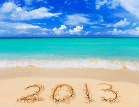 Numbers 2013 on beach - concept holiday background Stock Photo - 15879255