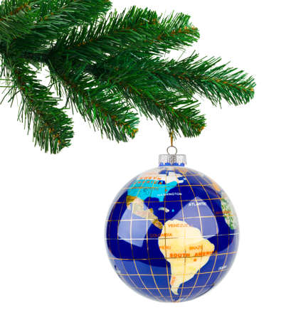 Globe and christmas tree isolated on white background photo