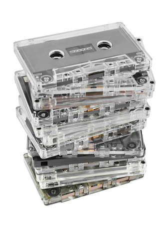 portable mp3 player: Stack of audio cassettes isolated on white background