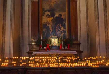 Icon and candles in cathedral at Salzburg Austria - religion background
