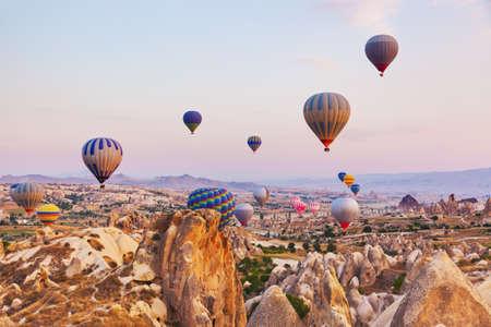 air balloon: Hot air balloon flying over rock landscape at Cappadocia Turkey Editorial
