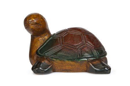 embossment: Wooden figurine of turtle isolated on white background