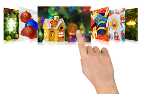 scrolling: Hand scrolling christmas images  my photos  - isolated on white background