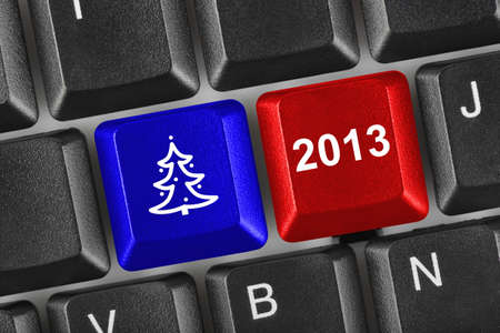 Computer keyboard with Christmas keys - holiday concept Stock Photo - 15990709