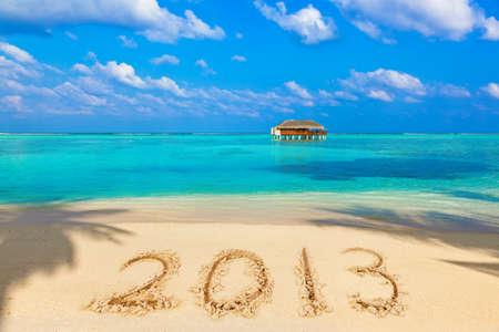 Zahlen 2013 am Strand - Konzept Urlaub Hintergrund Editorial
