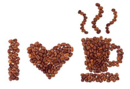 Heart made of coffee isolated on white background photo