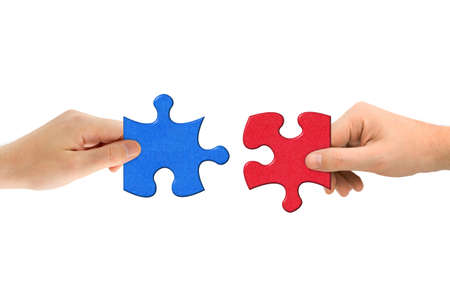 Hands and puzzle isolated on white background photo