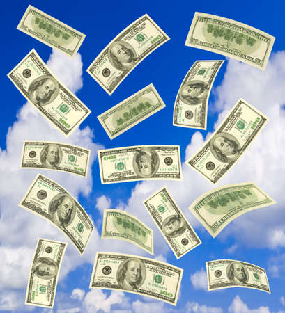 Falling money - blue sky on background photo