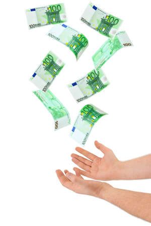 winning stock: Hand and falling money isolated on white background